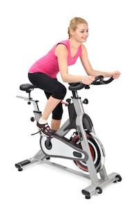 girl riding spin bike