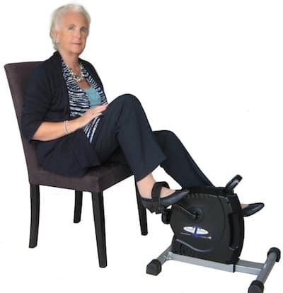 best pedal exerciser - older lady with mini exercise bike